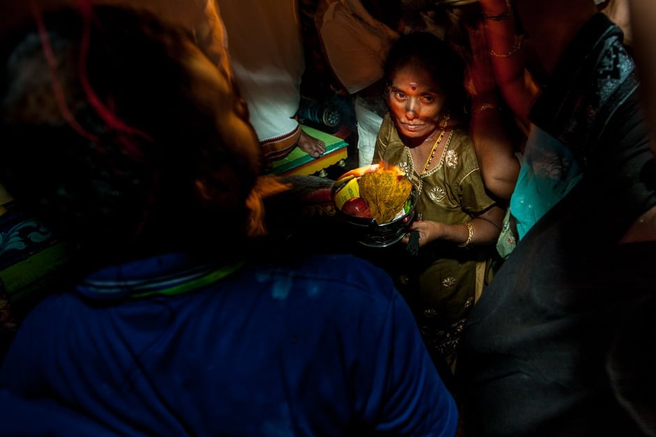 Lost in a sea of devotion. A woman gets crushed as she tried to give her offering to the god Murugan