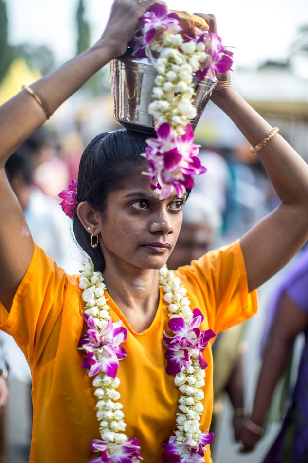 A woman with flowers and a pail of milk (pal Kavadi) proceeds up to the main temple and the climax of the pilgrimage.