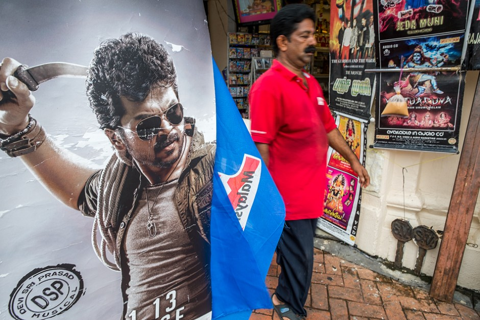 """A poster for the Tamil movie """"Alex Pandian"""" on the streets of Georgetown, Penang. Will violence will it's violence stay on the screen?"""