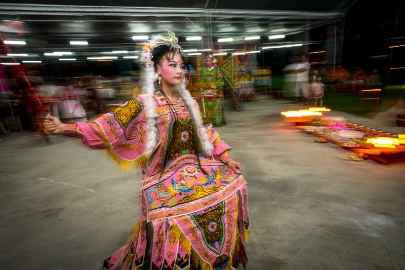 This actress does a performance before the king of hell.f/9, 1/20 sec, at 14mm, 3200 ISO, on a X-Pro1
