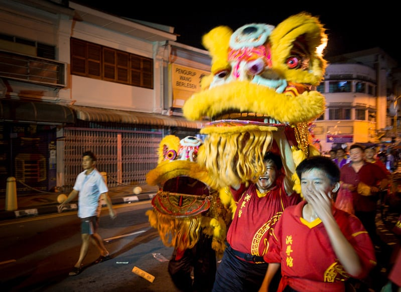A party like atmosphere ensues as the King is paraded around the community preceded by lion dancers.f/2.8, 1/30 sec, at 14mm, 2500 ISO, on a X-Pro1