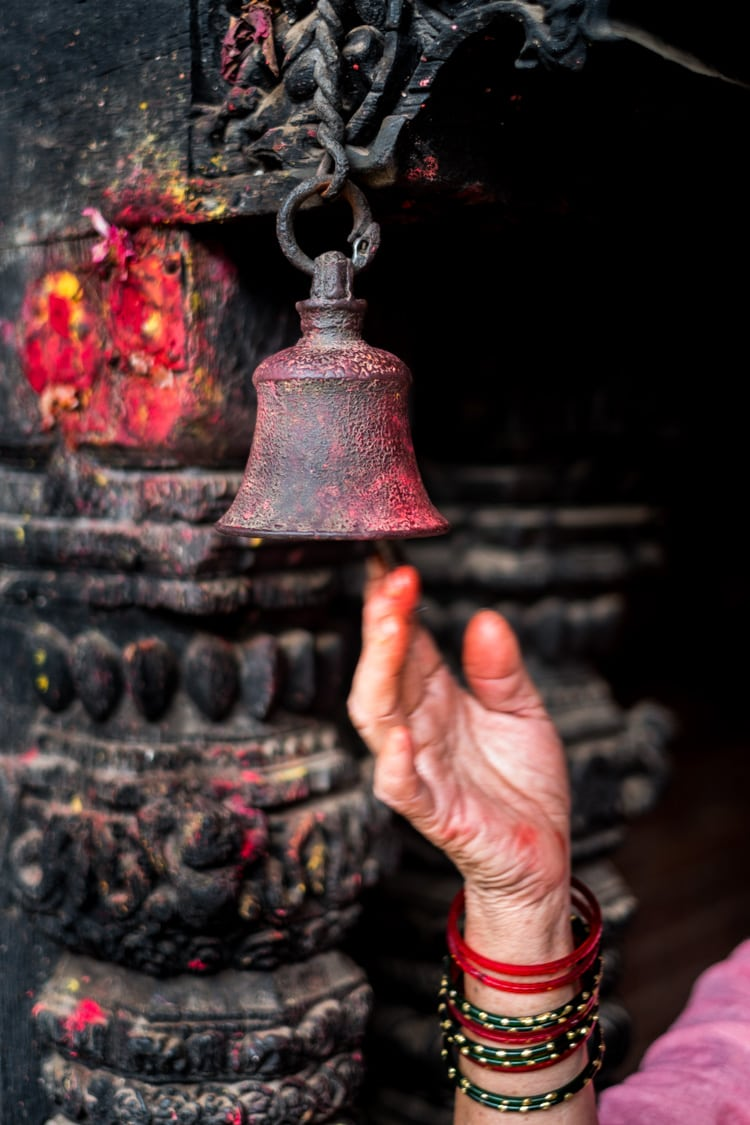 A hand rings the bell in a Hindu temple to awaken the godsf/1.4, 1/75 sec, at 35mm, 200 ISO, on a X-Pro1