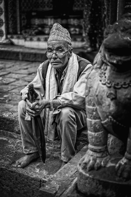 A priest sits on the steps of his temple.f/1.4, 1/170 sec, at 35mm, 200 ISO, on a X-Pro1