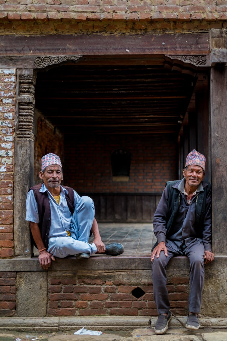 This seems to be a favorite pastime for men in Bhaktapur, sitting on these old porches. f/1.4, 1/500 sec, at 35mm, 200 ISO, on a X-Pro1